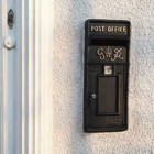King George rex post box front on house wall by door