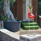 Tall Red Lady Bird Ornament in Situ in the Garden