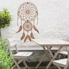 Dream Catcher Steel Wall Art  in Situ in the Garden by a Wooden Furniture Set