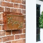 """Drustan"" Copper and Brass Celtic Design Post Box in Situ on a Wall"