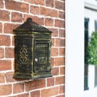 Wall Mounted Antique Bronze post box on brick wall