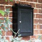 Simplistic post box on house wall