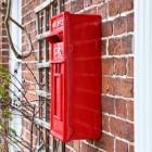 Side view of Red Elizabeth Regina Post Box