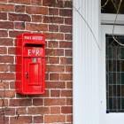 Red Elizabeth Regina Slim Post Box in Situ
