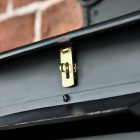 Close up of polished brass latch