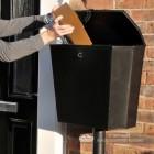 "Medium Size Parcel Being Put into the ""Billingsgate"" Large Secure Parcel Box"