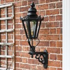 Black traditional porch lantern on brick wall