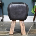 Side View of the Mago Wood & Black Buffalo Leather Stool
