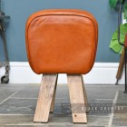 Side View of the Mango Wood & Tan Goat Leather Bug Stool