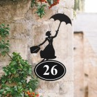 Mary Poppins Iron House Number Sign in Situ on a Rustic Wall
