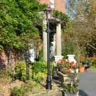 Traditional victorian lamp post in garden