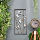 Metal Bamboo Metal Wall Art in Situ Next to Plants and  a Floor standing Clock