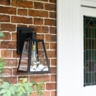 Modern Black Porch Wall Lantern Installed In Doorway