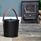 Black Modern Ash Bucket in Situ Next to the Fire Place