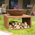 Modern Rustic Fire Bowl With Log Store in Situ in the Garden