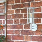 """""""Naltio"""" Contemporary Silver Wall Light in Situ on the Front of a house"""