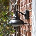 """Newport"" Marine Inspired Wall Lantern with Bracket in Situ on the Side of a House"