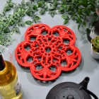 Red Cast Iron Flower Petal Trivet in Situ