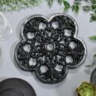 Black Cast Iron Flower Trivet in Situ