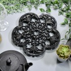 Black Cast Iron Flower Trivet in Situ with Teapot