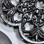 Black Cast Iron Flower Trivet Curved Detailing