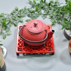 Red Cast Iron Square Trivet in Use with Teapot