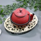 Cream Cast Iron Oval Trivet in Use with Teapot