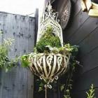 cream ornate scroll hanging basket