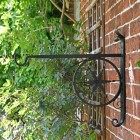 "Side View of the ""Northern Star"" Hanging Basket Bracket Mounted on a Brick Wall"