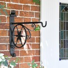 """Northern Star"" Hanging Basket Bracket in Situ by a Front Door"