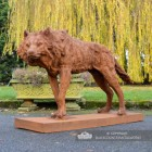 "Rustic Cast Iron ""Creeping"" Wolf Sculpture in Situ in the Garden"