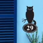 Iron Owl House Number Sign in Situ on a Blue Wall