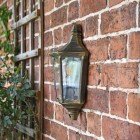 "Sid View of the ""Penley"" Flush Wall Light Mounted o a Brick Wall"