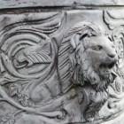 Impressive lion detail on bronze chariot sculpture