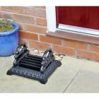 Pickwick art deco cast iron boot scraper outside