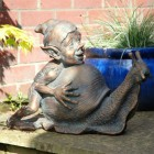 Pixie Pushing a Snail Garden Sculpture Finished in an Aged Bronze
