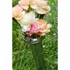 Aluminium conical vase in use in graveyard