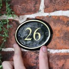 Polished Brass & Black Oval House Number Sign to Scale