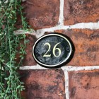 Polished Brass & Black Oval House Number Sign With Vinyl Numbers in Situ on the Front of A House
