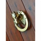 Horse door knocker on wood door