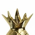 The crown of the pineapple door knocker