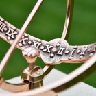 Close-up of the Roman Numerals on the Inside of the Polished Copper Armillary