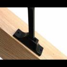 Black spindle bracket on stair