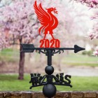 Liver Bird Weathervane in Situ by a Pink Blossom Tree