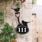 Robin Iron House Number Sign in Situ on a Rustic Wall