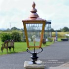 Copper Rochester Entrance Pillar Light in Situ on a Driveway