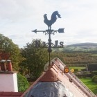 Rooster weathervane rustic finish on roof