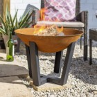 Rustic Fire Bowl with Black Legs in Situ in Garden
