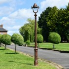 Rustic Copper Ornate Lamp Post Installed On Driveway