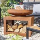Rustic Firepit & Log Holder in Use Holding Logs